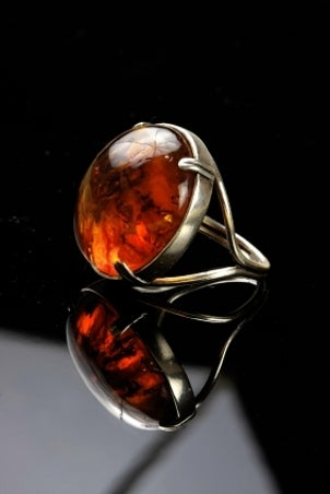 Men's gemstone jewelry ring with an amber gem
