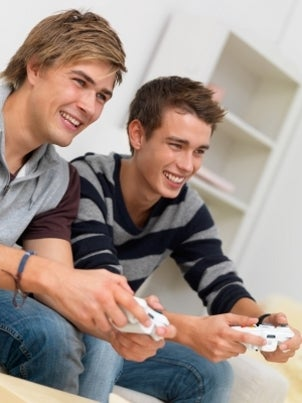 Boys playing games on a gaming television