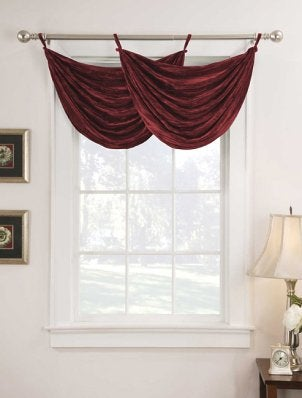 A simple window valance beautifully displays the windows