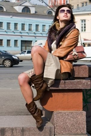 Woman in casual dress, boots and scarf
