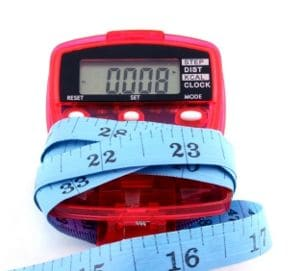 Pedometer wrapped in measuring tape