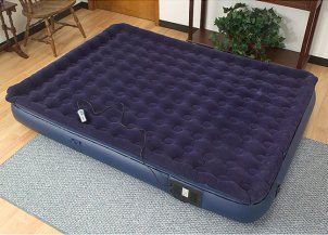 Blue air mattress in the guest bedroom