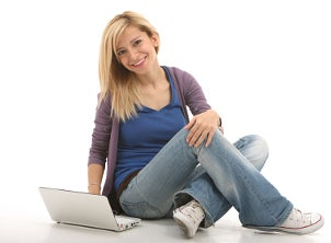 Girl holding a netbook PC computer