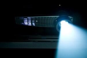 Projector shining light in a dark room