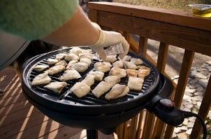 Grilling fish on the porch on an indoor-outdoor electric grill