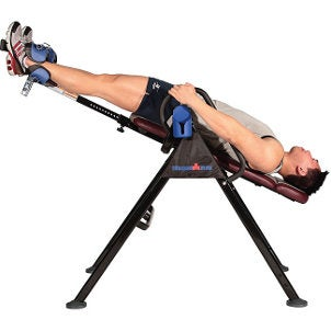Inverted man on an inversion table