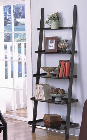 Ladder bookshelf with books and knick knacks