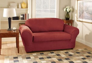Burgundy stretch suede slipcover elegantly protects sofa