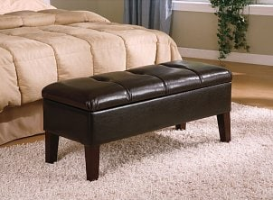 A leather storage bench in the bedroom