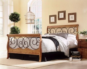 Ornate bed frame in bedroom