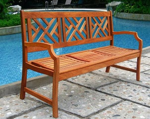 Wooden bench by an outdoor pool