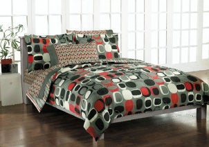 California King bed with a geometric pattern comforter