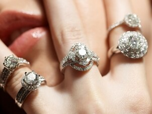 A woman wearing five beautiful cubic zirconia rings