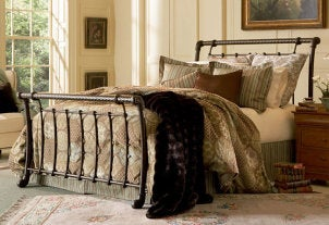 Comfortable bed with a bed skirt and oversized duvet