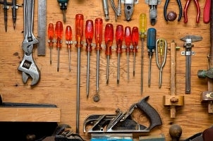 Hand tools hanging on pegboard