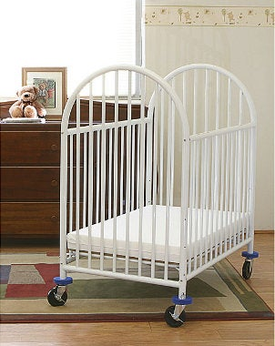 White portable crib in a baby nursery