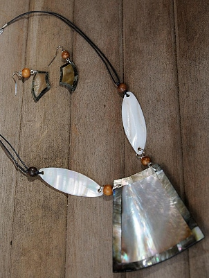 A large shell pendant and shell earrings