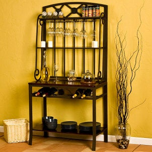 Decorative baker's rack with wine rack, wine glass holders and several shelves