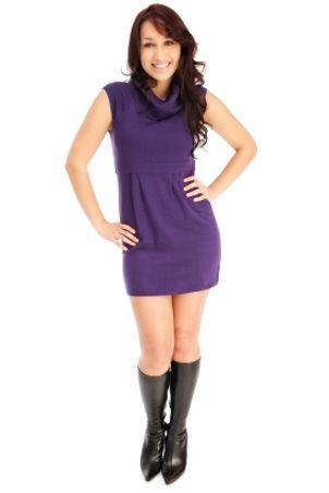 Woman wearing purple sweater dress and boots