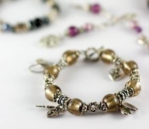 A pretty gemstone and silver charm bracelet
