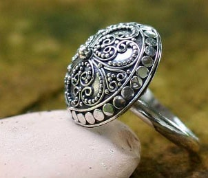 A beautiful domed sterling silver ring represents the sterling jewelry craze