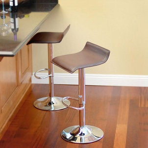 Two modern leather counter stools