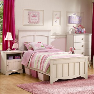 Nightstand and other bedroom furniture in a girl's bedroom