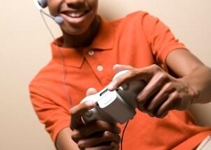 Young gamer wearing gaming headphones