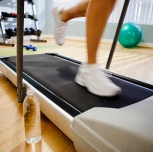 Woman staying fit on a treadmill in her home gym