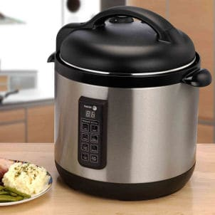 Stainless steel rice cooker sits on kitchen counter