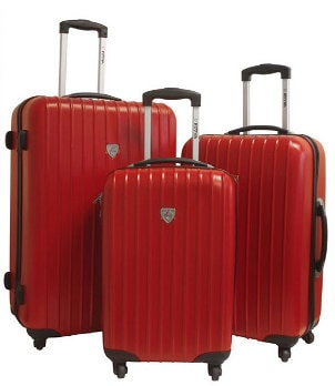 Det of stylish dark red suitcases