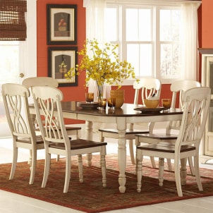 Trendy cream dining set with flowers on table