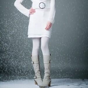 Woman wearing a white sweater dress in winter