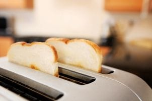 Toast pops out of stainless steel 4-slice toaster