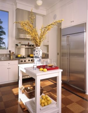 White kitchen cart holds fruit and decorative accents