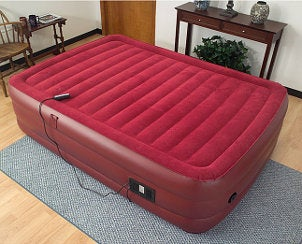 Red pillowtop air mattress in a guest bedroom