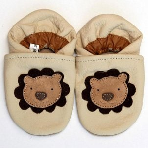 Slip-on baby shoes adorned with lions