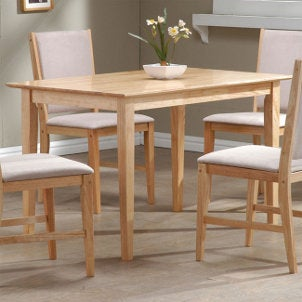 Light wooden dining table with padded chairs
