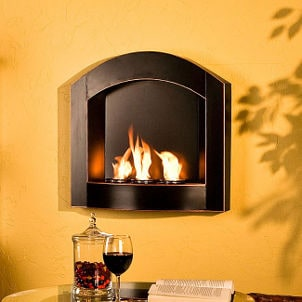 Wall-mounted indoor fireplace warms up yellow room