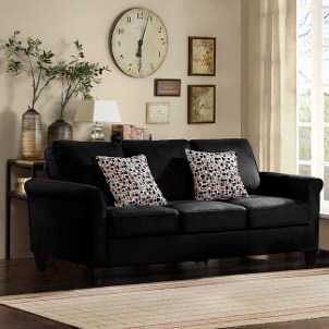Decorated living room with black sofa