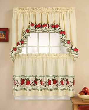 Apple-patterned curtains adorn kitchen window