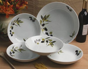 White porcelain bowls are painted with Tuscan olive pattern