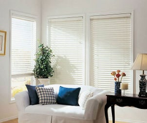 white window blinds complement white loveseat