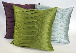 Faux silk throw pillows add glamour to your home