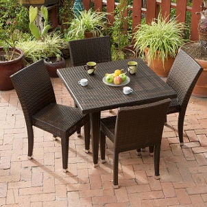 Dark brown wicker outdoor furniture dresses up patio