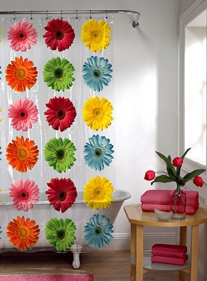 Bright vinyl flower shower curtain in a cute bathroom