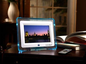 Blue-rimmed digital photo frame lights up dark office