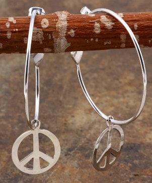A pair of cute novelty peace sign hoop earrings