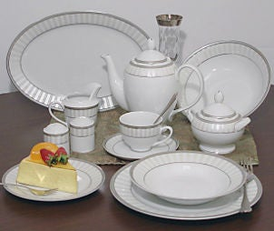 Slice of cheesecake complements formal dinnerware set