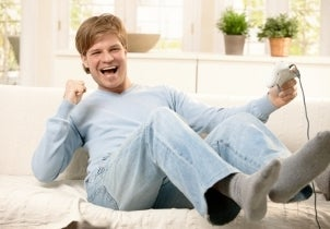 Man playing Xbox 360 in his mom's living room